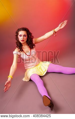 Portrait Of Young Caucasian Female Posing In Colorful Clothing In Dolly Style Against Color Backgrou