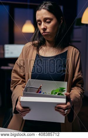 Desperate Layed-off Feeling Stressed About Job Loss At Workplace. Sad Woman Holding Her Belongings L