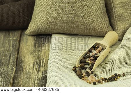 Sea Salt And Allspice On A Wooden Spoon. Spices Salt Pepper And Mustard Seeds On A Light Wooden Back
