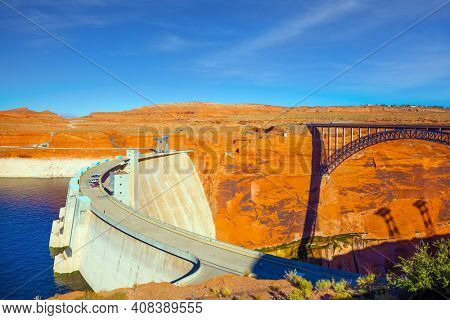 Glen Canyon Bridge over the Colorado River next to the Glen Canyon Dam. The red sandstone is the base of the bridge. The best journey in life. The concept of active and photo tourism