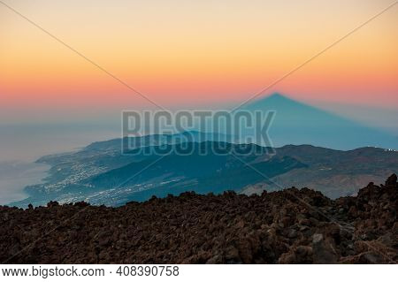 Silhouette Of Shadow Of Volcano Del Teide  At Sunset. Pico Del Teide Mountain In El Teide National P