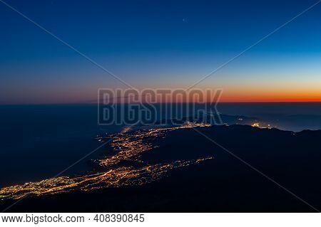 Tenerife Coastline Lights At Dawn Before Sunrise From Pico Del Teide Mountain In El Teide National P