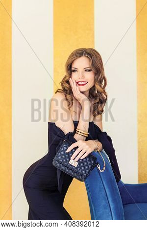 Happy Glamorous Young Woman Fashion Portrait. Luxury Style