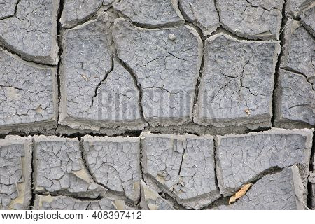 Ecology, Drought, Temperature, Cracks In The Ground Close-up. Cracked Earth, Cracked Soil. Texture O
