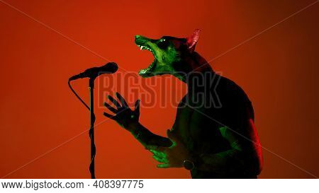 Rockstar. Talented Dog, Professional Musician Performing On Deep Red Background In Neon Light. Conce