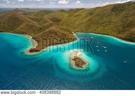Aerial view of Waterlemon Cay with boats harboring in the bay on the island of St. John in the United States Virgin Islands.