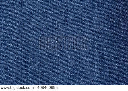 Denim Blue Jeans Fabric. Denim Background Texture For Design. Canvas Denim. Blue Jeans Texture For A
