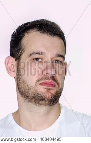 Portrait Of A Young Man. Handsome Young Guy Of The European Type Looks At The Photographer. Face Of