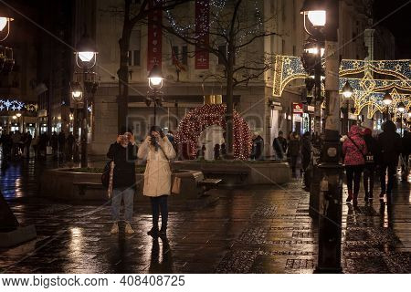 Belgrade, Serbia - December 27, 2020 Two Young Women, Friends, Talking Pictures And Shooting With Th