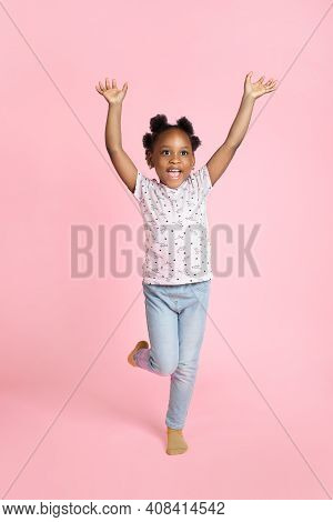 Smiling Happy Little African American Kid Girl 6-7 Years Old Wearing Casual Clothes, Standing With H