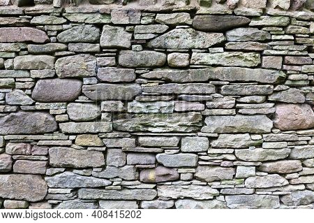 Dry Stone Walls Or Stonewalls Background And Texture Made From Layered Regular Shaped Natural Slate