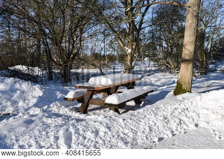 Snow Covered Furniture By A Resting Place In A Nature Reserve On The Island Oland In Sweden