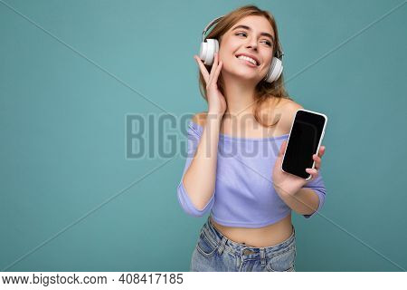 Photo Of Beautiful Joyful Smiling Young Woman Wearing Stylish Casual Clothes Isolated Over Backgroun