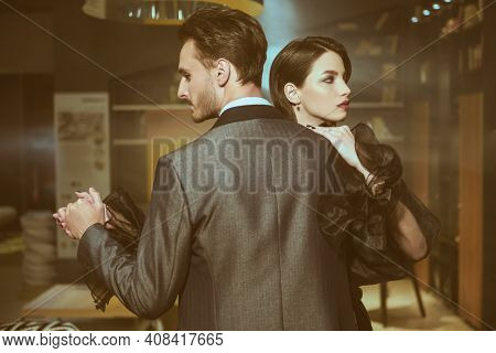 Beautiful couple in love dancing tango with passion. Evening make-up and hairstyle. Fashionable clothes.