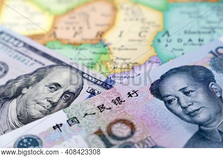 Us Dollar And Chinese Yuan On The Map Of Africa. Rivalry Between The Usa And China On The African Co
