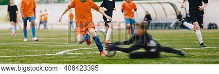 Youth Players Kicking Soccer Match On Grass Stadium. Kids Kicking Football Ball. Boys Play Soccer On