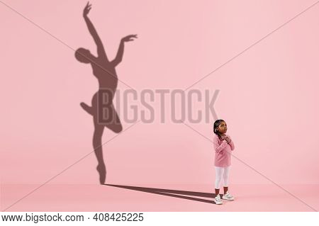 Childhood And Dream About Big And Famous Future. Conceptual Image With Girl And Drawned Shadow Of Fe