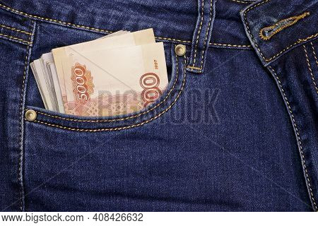 A Stack Of Russian Five-thousandth Ruble Bills In A Pocket Of Blue Jeans. Money In Your Pocket, Cash