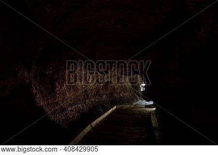 Old Stone Bat Cave In The Rock. Tourist Attraction. Walk In The Cave.