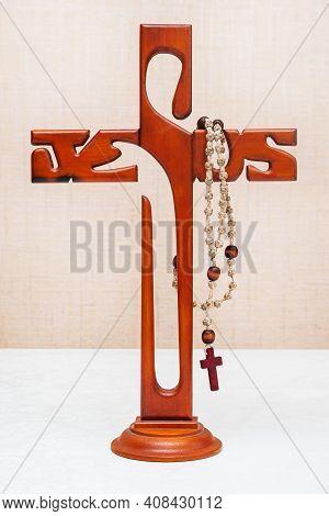 Krasnoyarsk, Russia - February 14, 2021: Catholic Cross And Holy Rosary. Catholic Attributes.