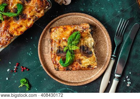 A Piece Of Vegetarian Lasagna With Mushrooms, Tomatoes And Basil, Top View