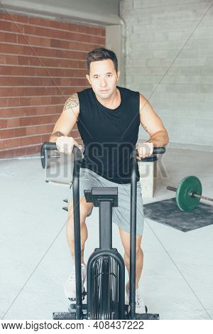 Close Up View Of A Young Sporty Tattooed Young Man Doing Calorie Assault Exercises. Workout Routine