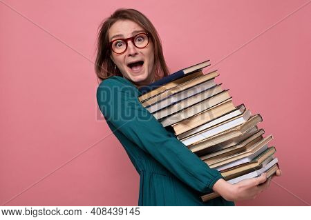 Young Happy Beautiful Woman Holding Books Studying For Exam.