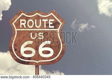 Retro Weathered Route Us 66 Highway Sign With Blue Sky 3d Illustration