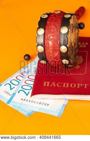 Passport And Toy Egyptian Tambourine Lie On Russian Ruble Banknotes