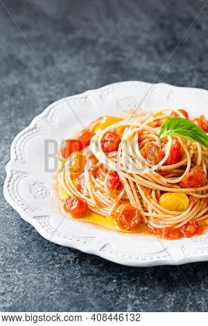 Close Up Of Plate Of Rustic Italian Cherry Tomato Spaghetti Pasta