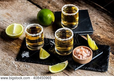 Three Tequila Shot Glasses With Salt And Lime Mexican National Drink. Golden Tequila Shots. Mexican