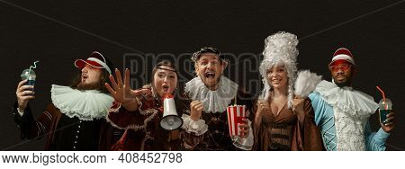 Party, Hanging Out, Cheers. Medieval People As A Royalty Persons In Vintage Clothing On Dark Backgro