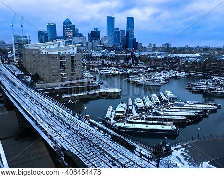 Canary Wharf London, England - February 8, 2021 Snow Docklands Canary Wharf Limehouse Docks Cloudy C