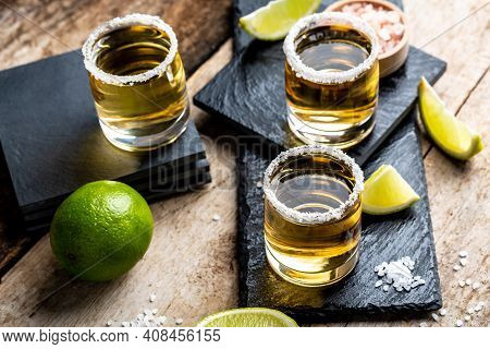 Tequila Shots With Salt And Lime Mexican National Drink. Golden Tequila Shots. Mexican National Drin