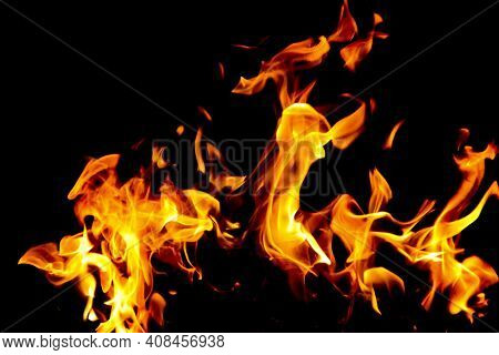 Fire Flames On Black Background. The Fire In The Natural Forest, Flames And Sparks On A Dark Backgro