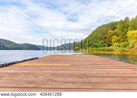 Fishing Tourism Relax Concept. Beautiful Forest Lake Or River On Sunny Summer Day And Old Rustic Woo