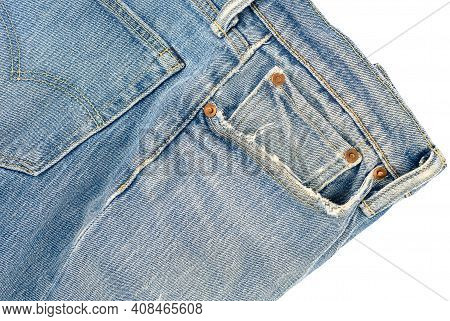 A Pocket Of Old Jeans, Frayed And Loose Threads. Close Up And White Background.