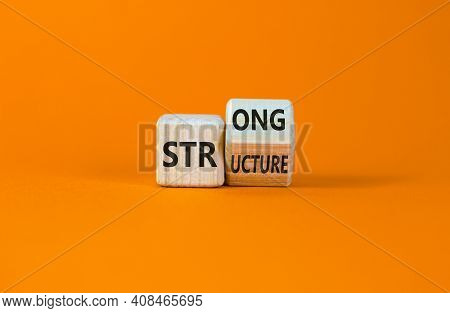 Strong Structure Symbol. Turned A Wooden Cube With Words 'strong Structure'. Beautiful Orange Backgr