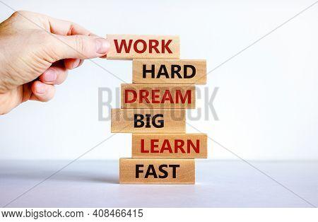 Work Hard Dream Big Symbol. Words Work Hard Dream Big Learn Fast On Wooden Blocks On A Beautiful Whi