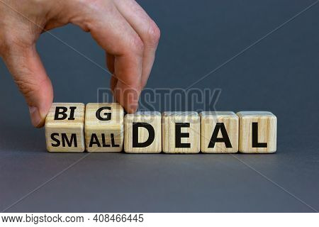 Big Or Small Deal Symbol. Businessman Turns A Wooden Cube And Changes Words 'small Deal' To 'big Dea
