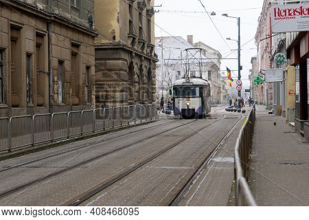 Timisoara, Romania - January 04, 2020: People Walking On The Street. Tram In The Background. Real Pe