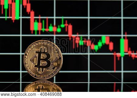 Close Up Photo Of Golden Shiny Litecoin Standing On The Background With Digital Colorful Candle Grap
