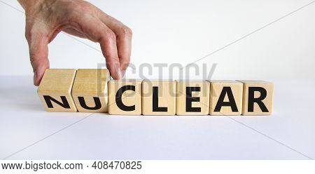 Nuclear Or Clear Symbol. Businessman Turns A Cube And Changes The Word 'nuclear' To 'clear'. Beautif