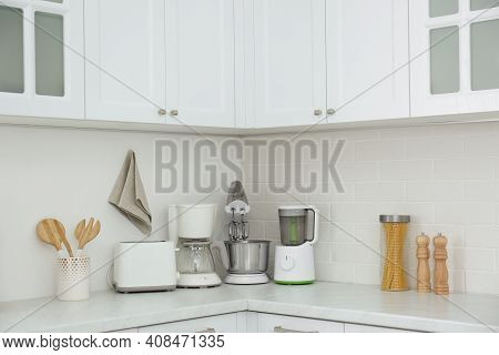 Modern Toaster And Other Home Appliances On Countertop In Kitchen