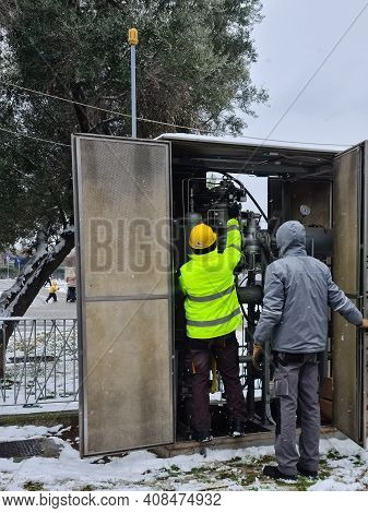 Thessaloniki, Greece - February 14 2021: Gas Technician Inspects A Distribution Pipe Under Bad Weath