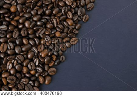 Roasted Coffee Beans On A Dark Background. Coffee Beans Texture. Coffee In Beans On Dark Background.