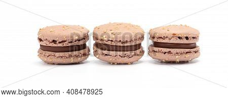 Three Cake Of Macarons Or Macaroons Brown Color. Delicious Chocolate Macaroons Isolated On White Bac
