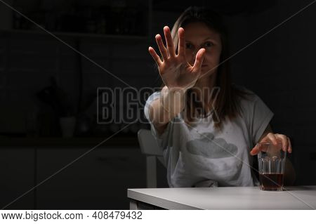 Depressed Sad Young Woman Feeling Bad Drinking Whiskey Alone At Home, Showing Hand Stop Alcohol, Alc