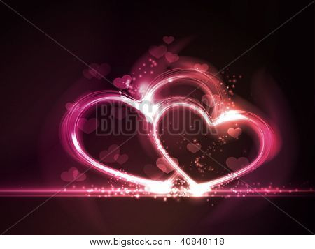 Overlying semitransparent heart shapes with light effects form glowing hearts frame in shades of pink, purple and red on dark red background. Contains gradient mesh elements, eps10. Copy space.