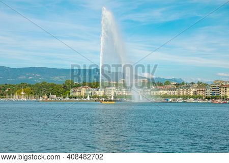 View Of Jet Deau Fountain Or Water Jet Fountain, Harbor And Geneva Lake. The Most Famous Attraction